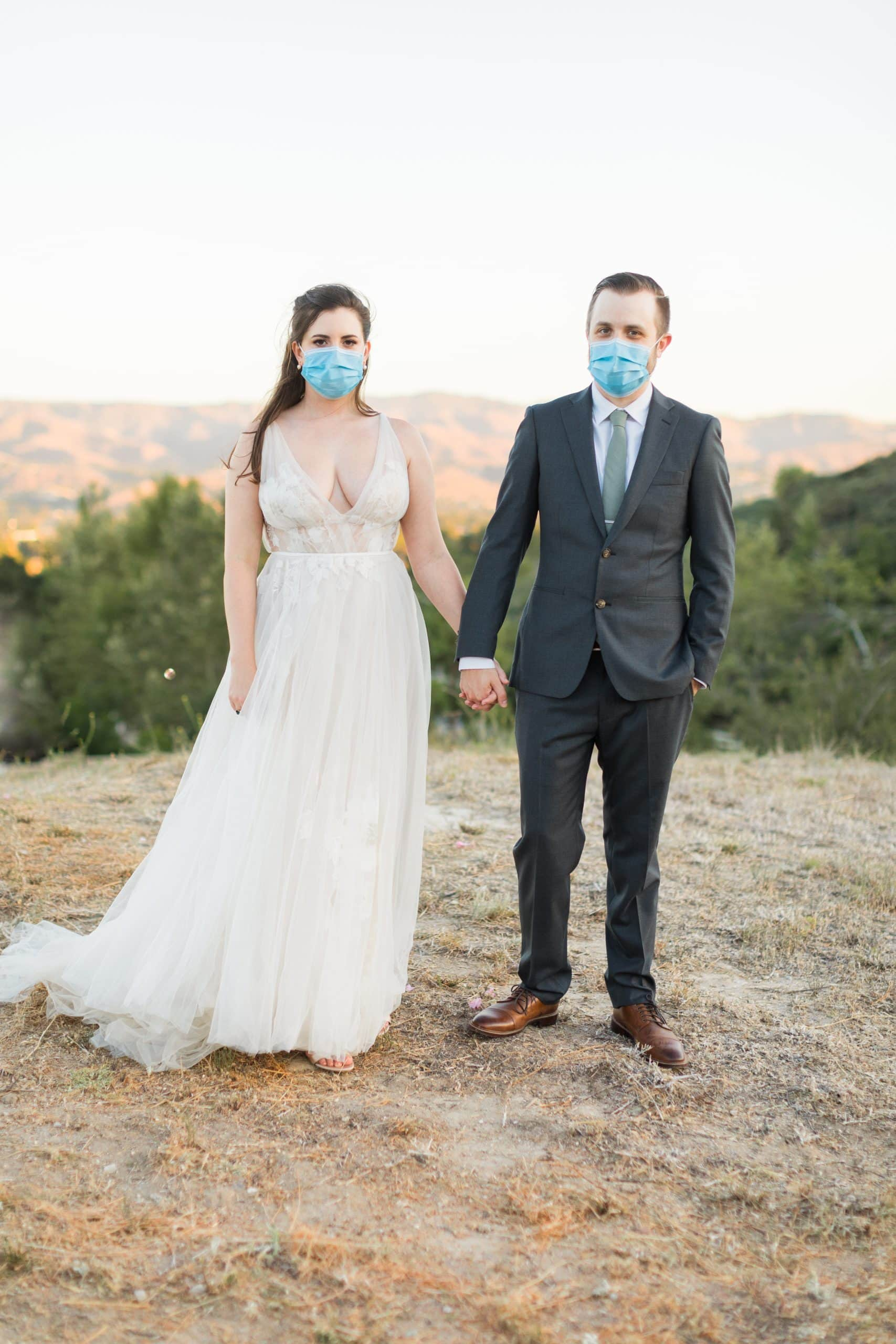 covid wedding bride and groom wearing masks